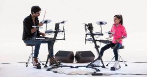 Man and girl play at Roland TD-1K Entry Level V-Drums Kit
