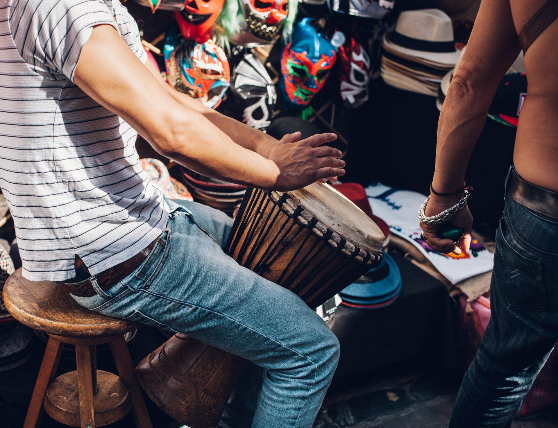man playing on bongo