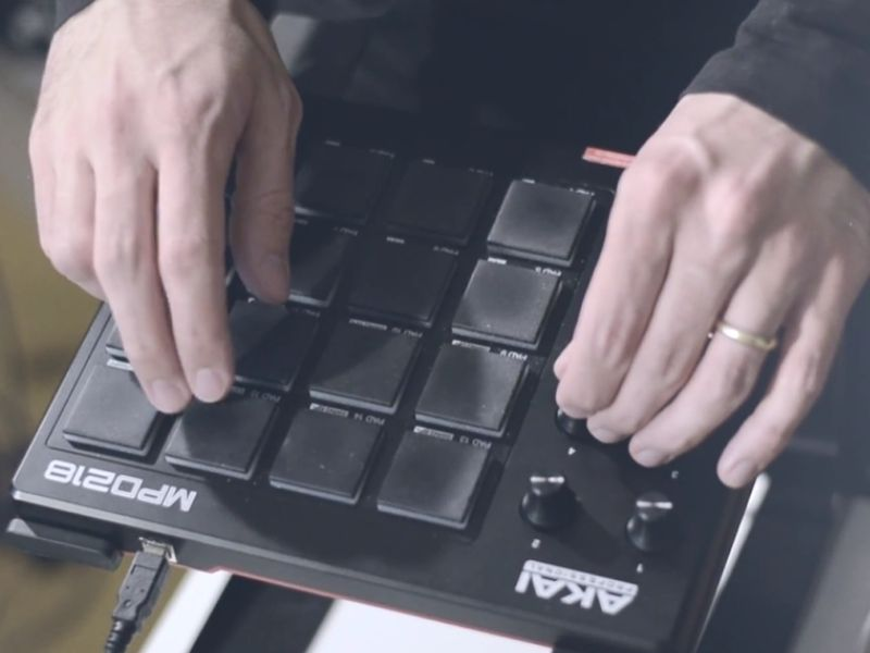 hands on a midi drum pad