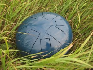 steel tongue drum in grass